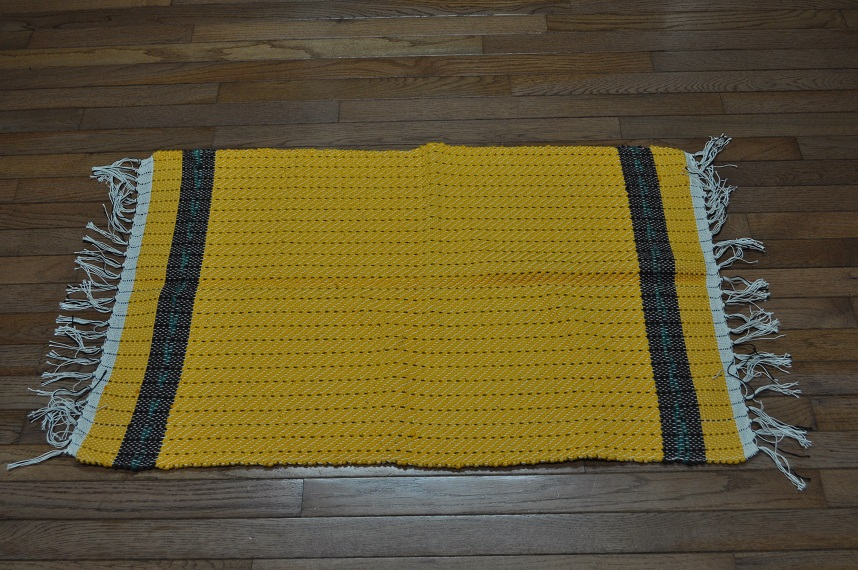 YELLOW RUG WITH BROWN AND GREEN